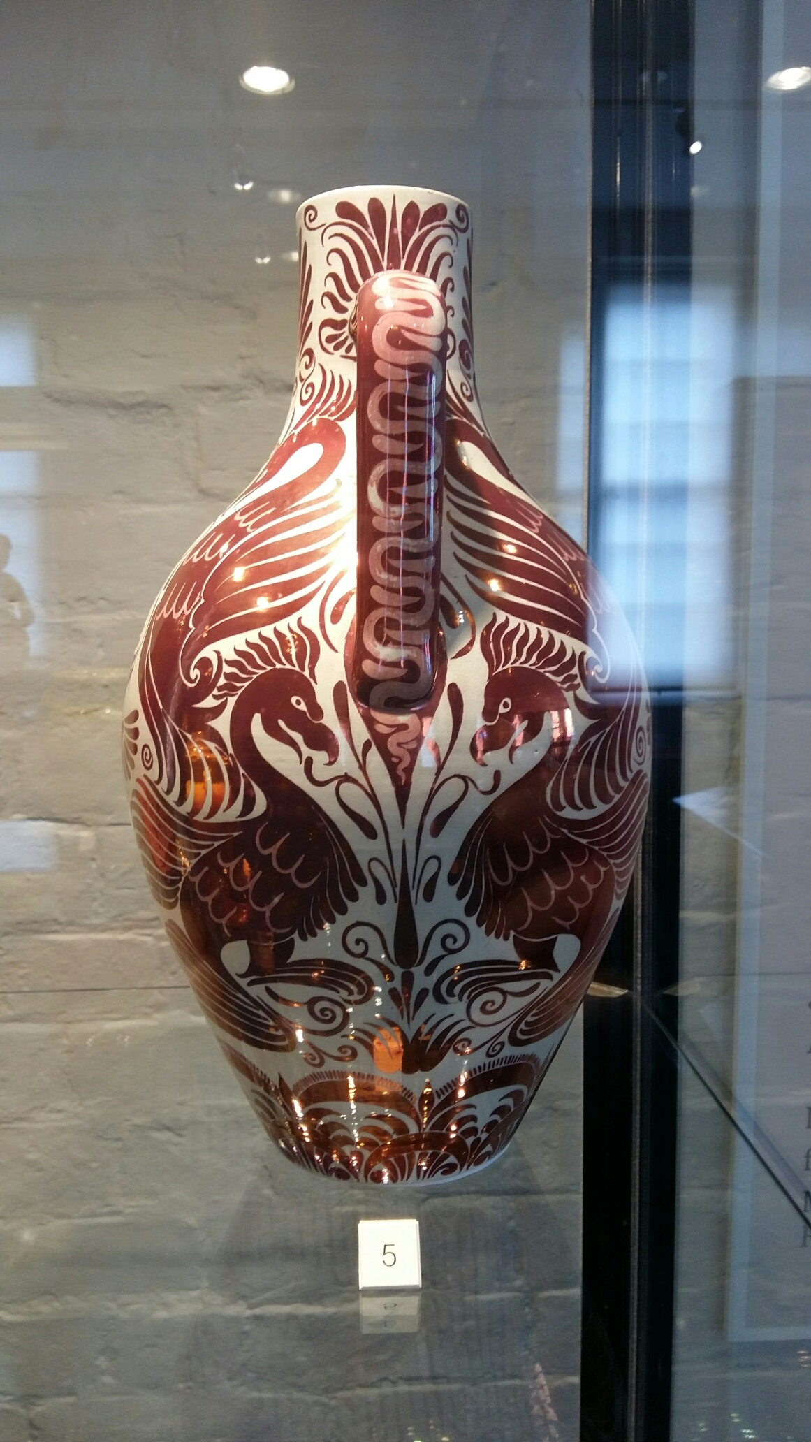 Earthenware vase decorated in Chinese style, dated 1909. Made by Bernard Moore