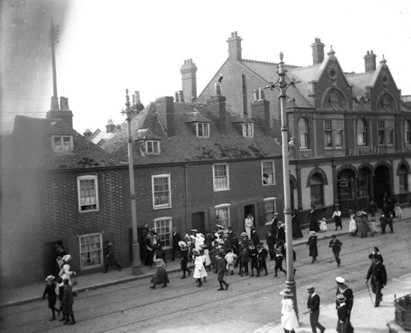 Historic photograph of The Fountain pub with people outside